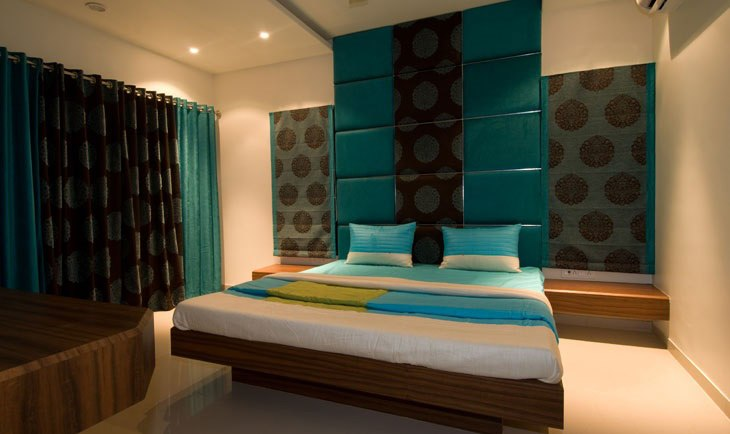 Low Rise Wooden Bed And Prussian Blue Head Cover by Deepti Srivastava Bedroom Minimalistic | Interior Design Photos & Ideas