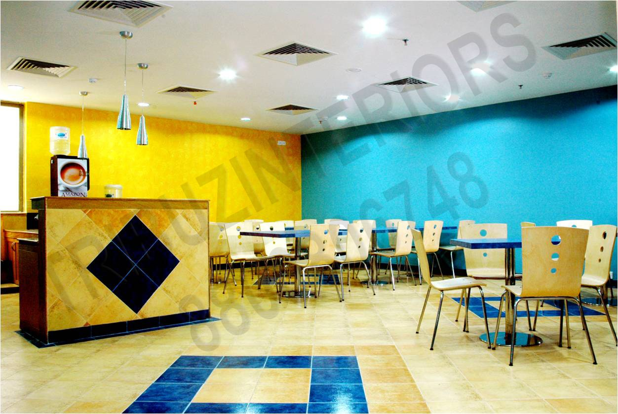 Yellow And Yellow Cafeteria With Reception  Desks by Tribuz Interiors Pvt. Ltd. Modern | Interior Design Photos & Ideas