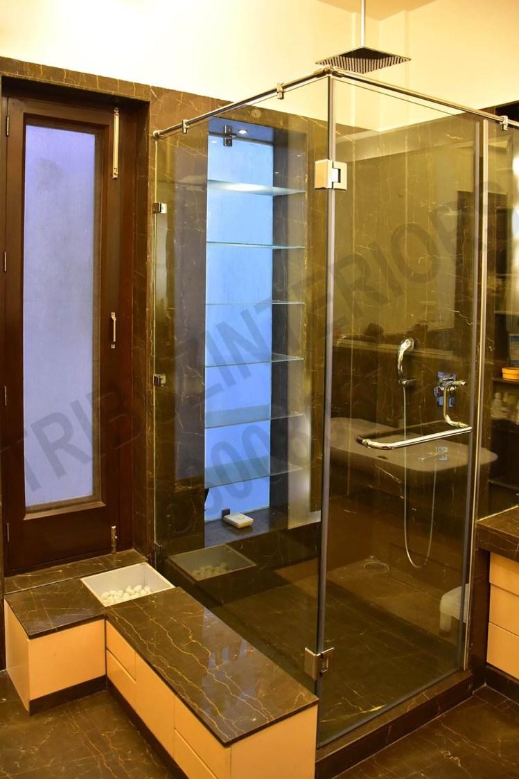 Bathroom Designed With Marble Floor And Glass Shower Stall by Tribuz Interiors Pvt. Ltd. Bathroom Modern | Interior Design Photos & Ideas
