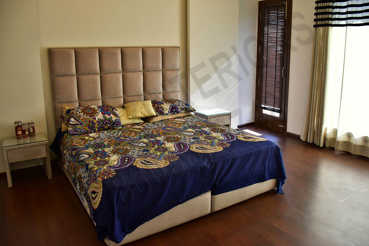 Master Bedroom With Cushioned Bed And Wooden Floor by Tribuz Interiors Pvt. Ltd. Bedroom Contemporary   Interior Design Photos & Ideas