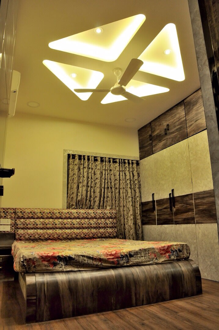 Bedroom With Oak Wooden Flooring And Printed Headboard by Rohit Mangal Singla Bedroom Modern | Interior Design Photos & Ideas