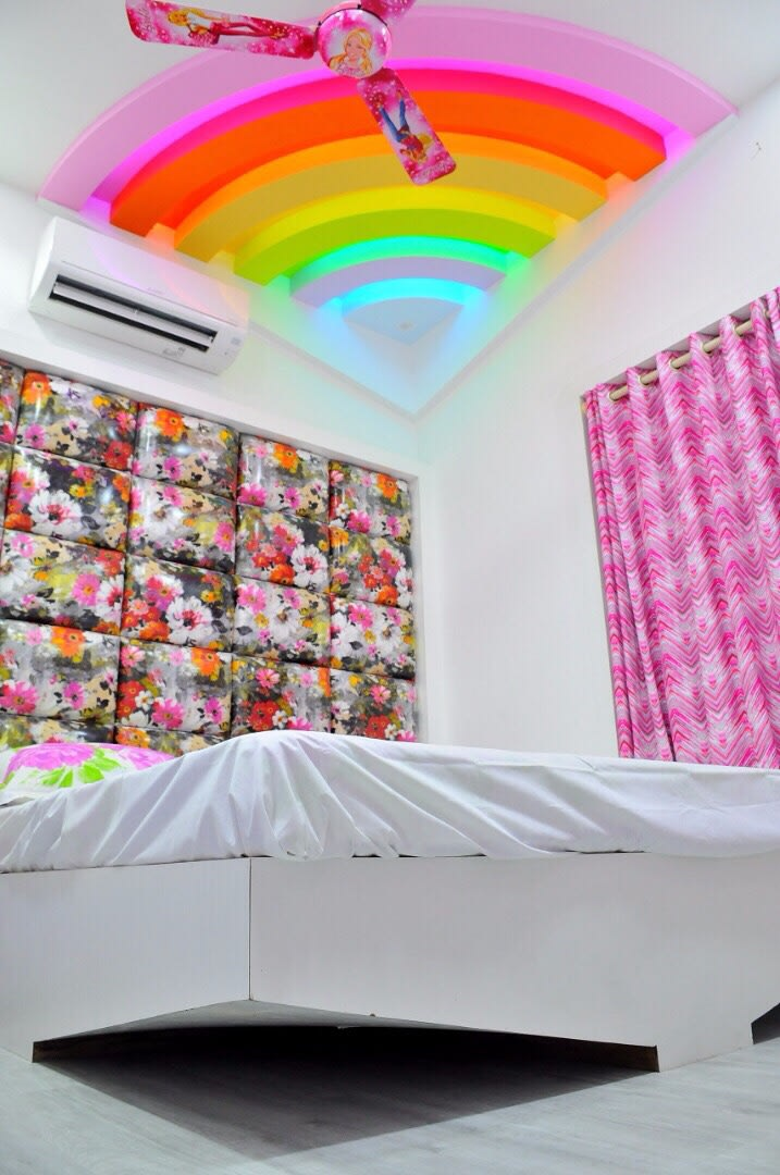 Kids Room False Ceiling Design: Kids Bedroom With Floral Cushioned Headboard And Rainbow