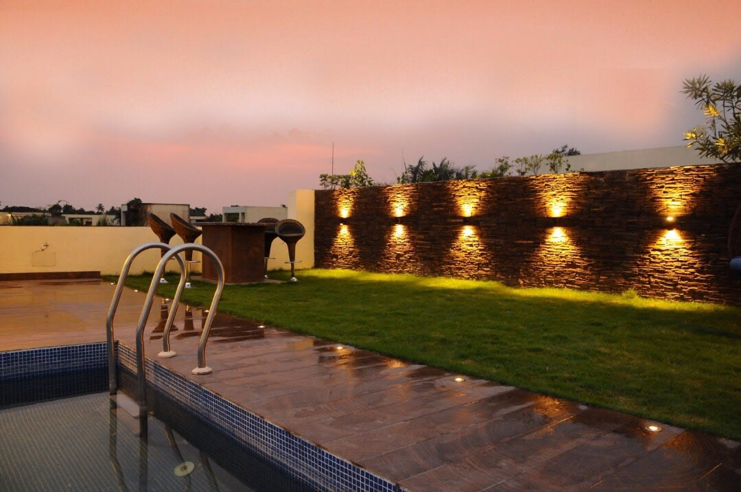 Swimming Pool With Lounge Chairs And Table by Rohit Mangal Singla Open-spaces Modern | Interior Design Photos & Ideas