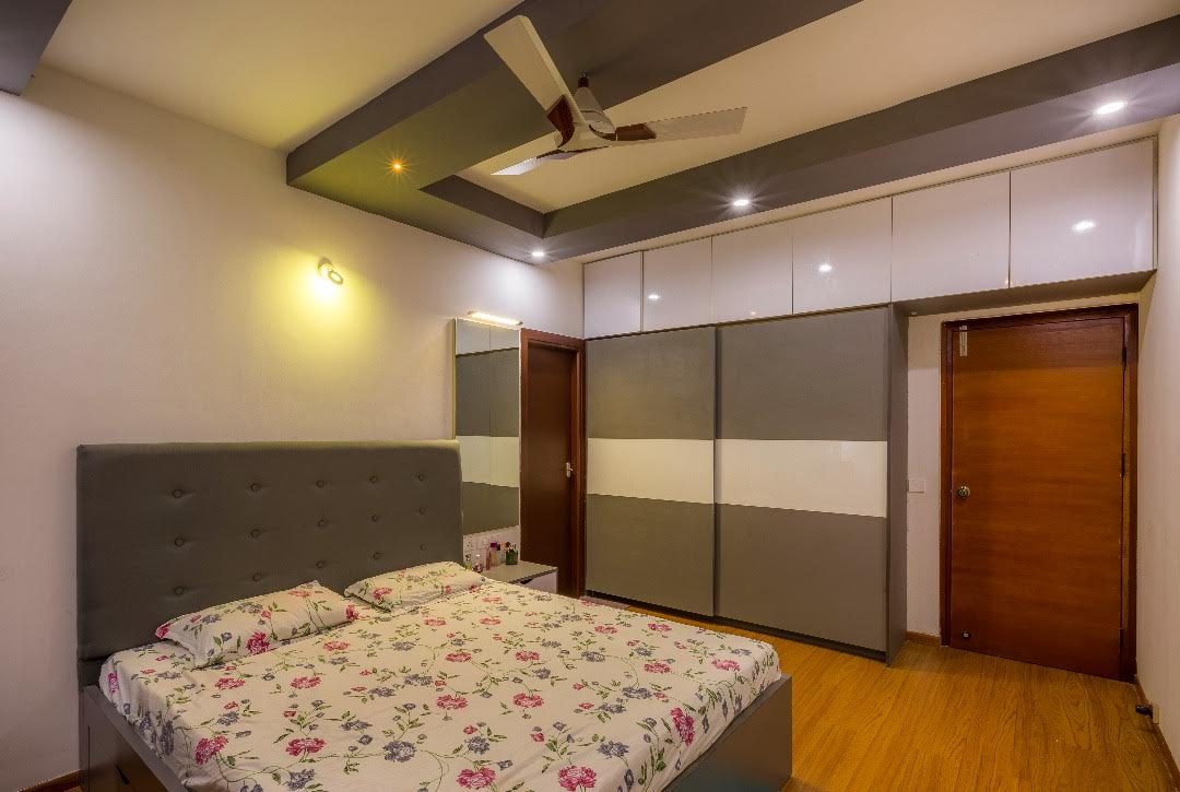 Contemporary bedroom with wooden flooring by Shubhashis Shomil Bedroom Contemporary | Interior Design Photos & Ideas