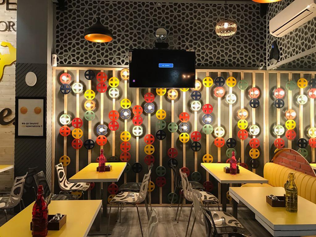 Playful Restaurant place by Yachna Khanna