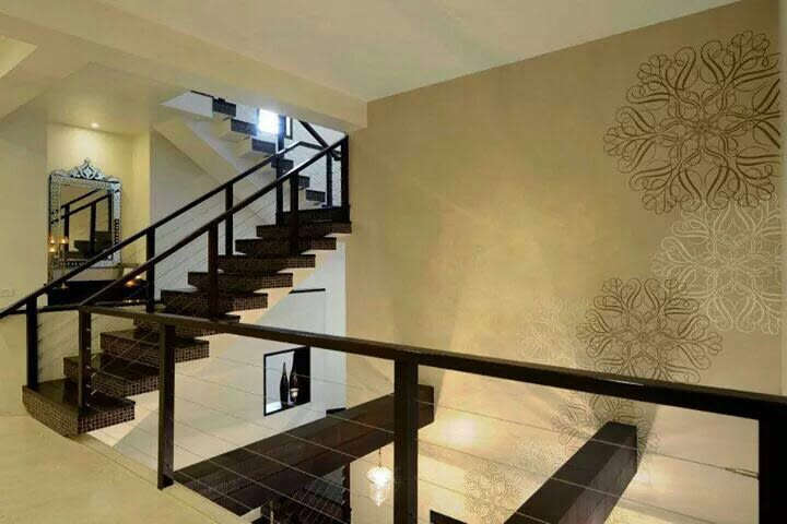 Hallway with staircase and wall decor by Milind Kapadia Indoor-spaces Modern | Interior Design Photos & Ideas