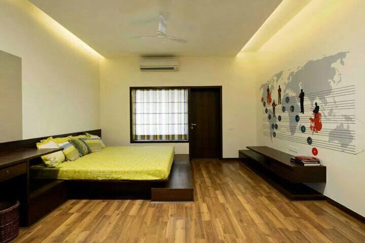 Bedroom with wooden flooring and false ceiling by Milind ...
