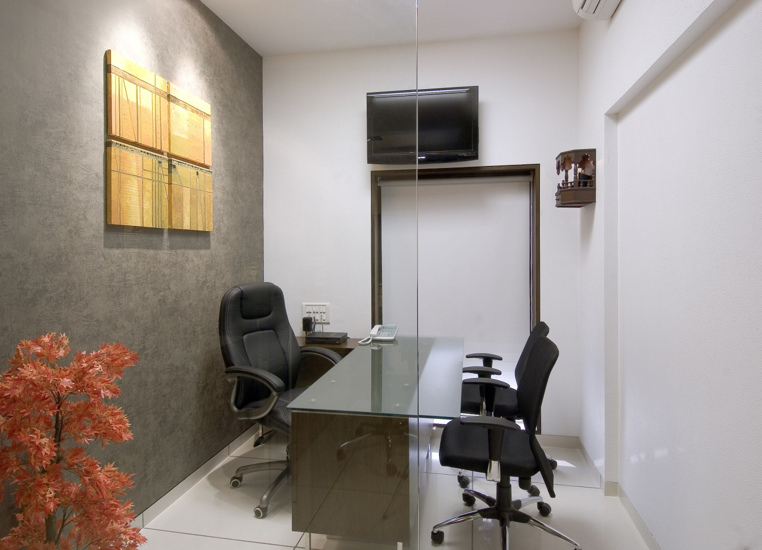 Cellular office with black chairs and tv unit by Milind Kapadia Contemporary | Interior Design Photos & Ideas