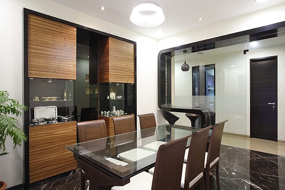 Dinning space with brown furniture and wooden display unit by Milind Kapadia Dining-room Modern | Interior Design Photos & Ideas
