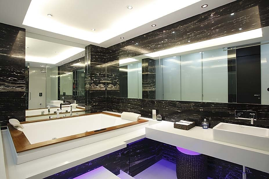 Bathroom with lavishing white bath tub and elegant wall design by Milind Kapadia Bathroom Modern | Interior Design Photos & Ideas