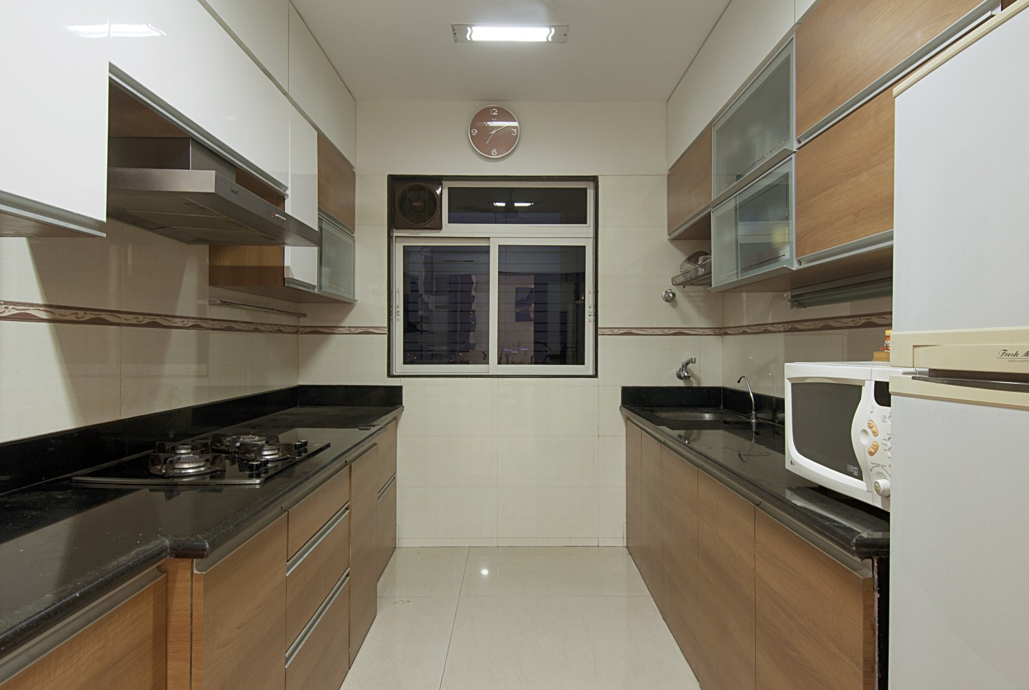 Parallel Shaped Modular Kitchen with cabinets by Milind Kapadia Modular-kitchen Contemporary | Interior Design Photos & Ideas