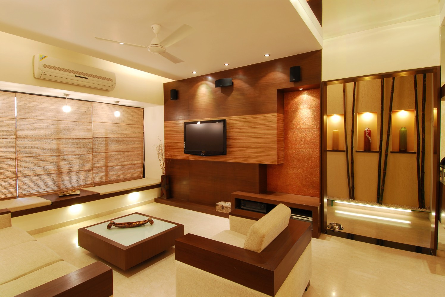 Living area with creamy sofa and modern display by Milind Kapadia Living-room Modern | Interior Design Photos & Ideas