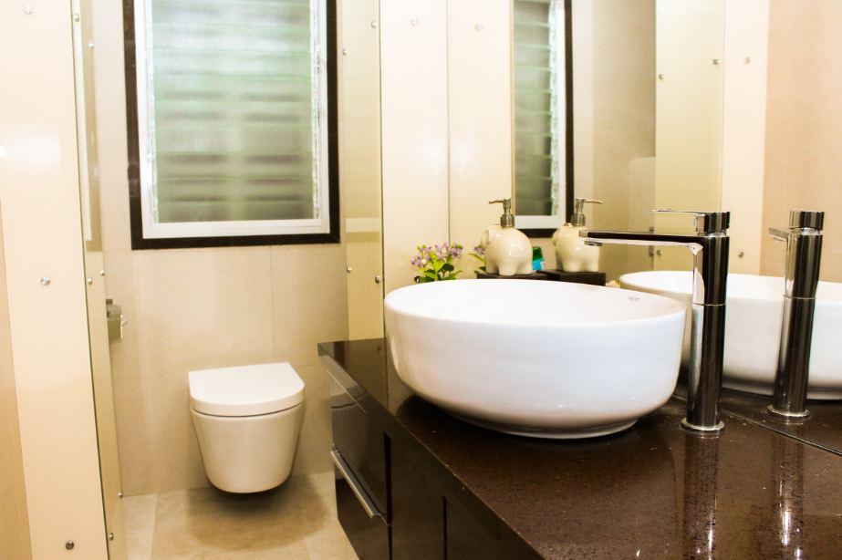 Dark Brown Cabinet In Beige Bathroom Interior by VERSATILE INTERIORS  Bathroom Modern | Interior Design Photos & Ideas