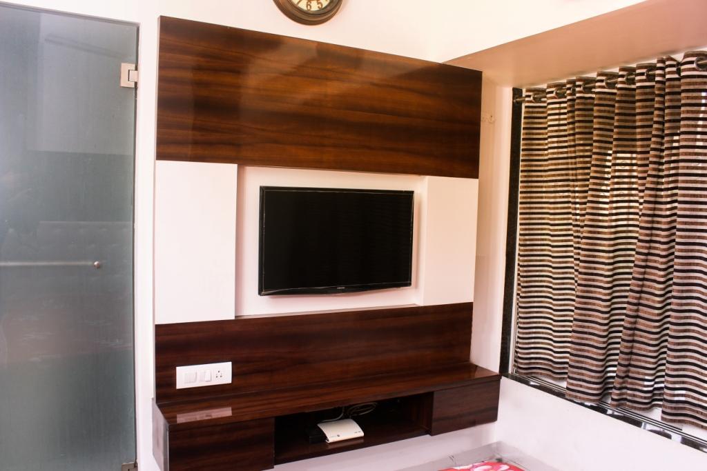Brown Sleek Entertainment unit by VERSATILE INTERIORS  Living-room Modern | Interior Design Photos & Ideas