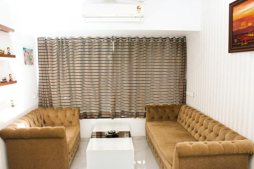 Beige Sofa Set And Stripped Curtains In Living Area by VERSATILE INTERIORS  Living-room Contemporary   Interior Design Photos & Ideas