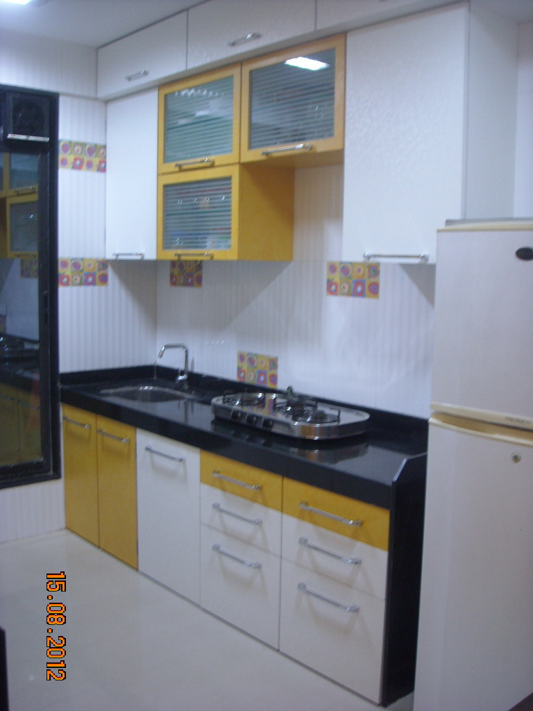 White And Yellow Kitchen by Aparna Mayekar Varadkar Modern | Interior Design Photos & Ideas