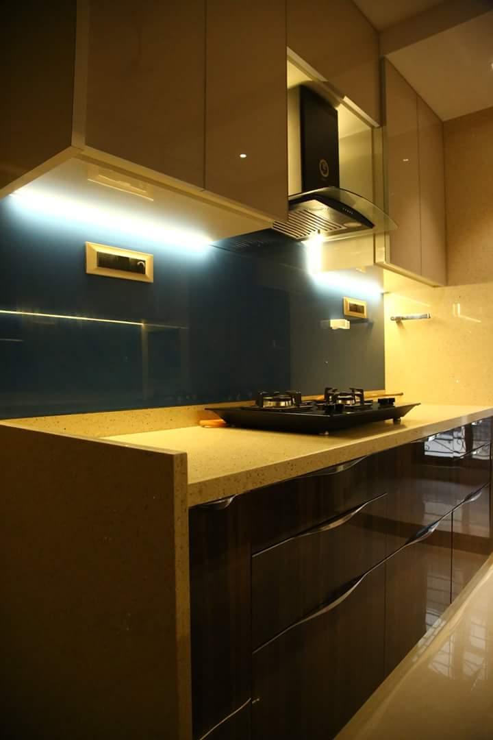 Modular Kitchen with Walnut Brown Wooden Cabinets by Atit Barbhaya Modular-kitchen Modern | Interior Design Photos & Ideas