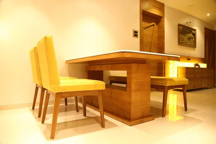 Dinning space with wooden table and yellow chairs by Atit Barbhaya Dining-room Modern | Interior Design Photos & Ideas