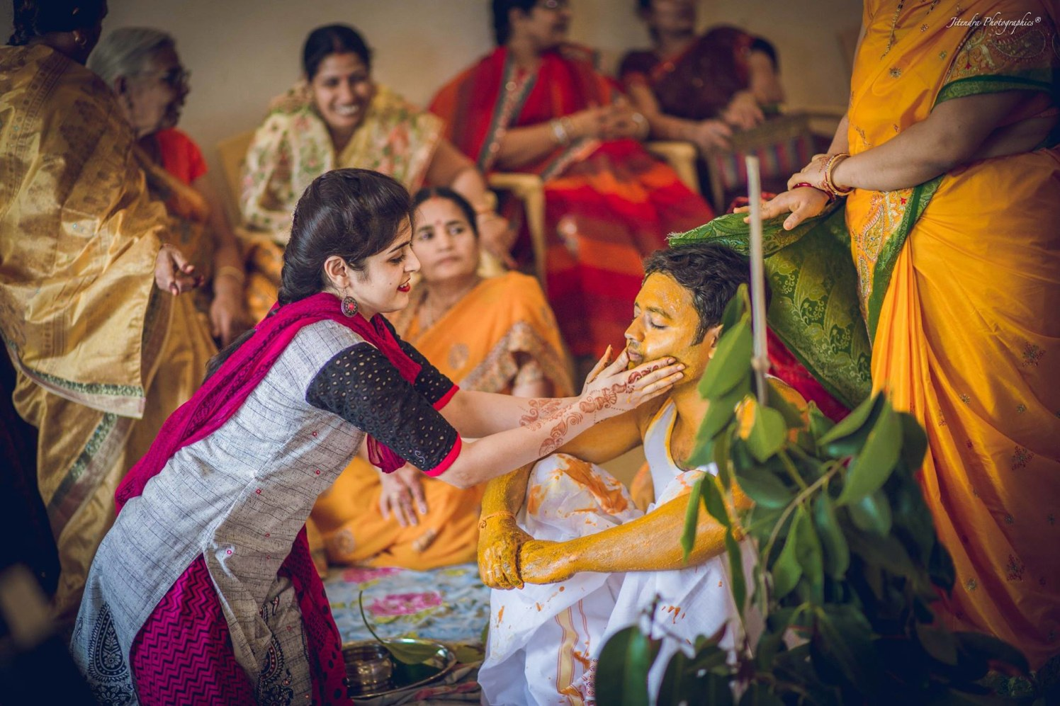 Applying haldi by The Dark Room Photography Wedding-photography | Weddings Photos & Ideas