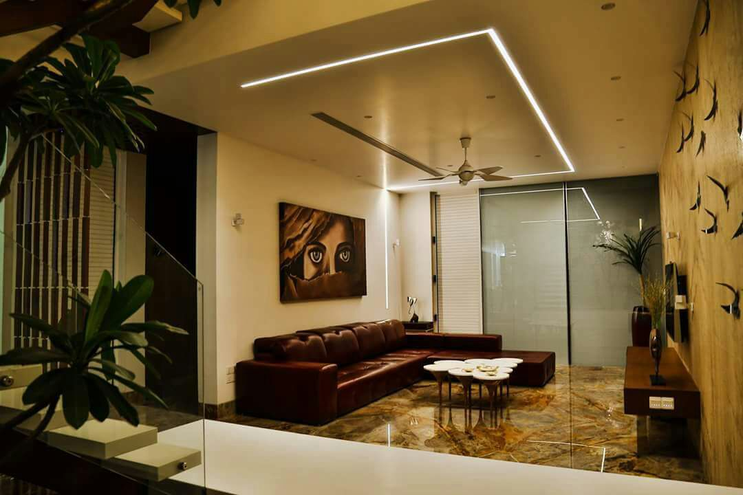 marble floored living room by Chandni Goel Modern | Interior Design Photos & Ideas