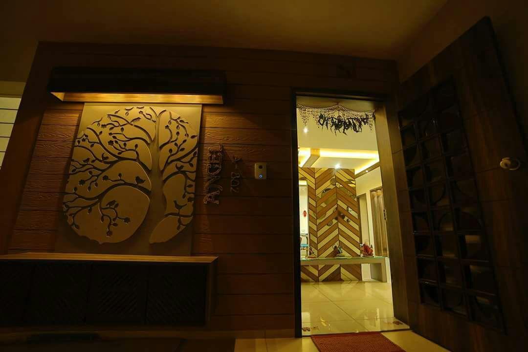 designer mantle piece by Chandni Goel Modern | Interior Design Photos & Ideas