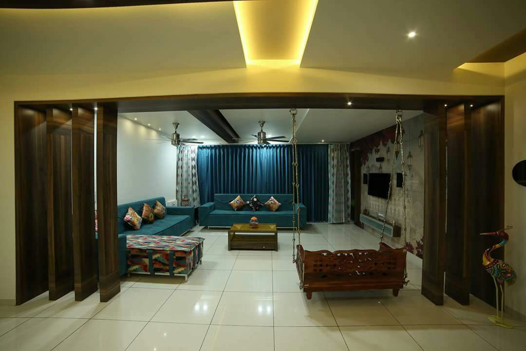 Spacious Living space with marble flooring and false ceiling with blue sofa and colored cushions by Chandni Goel Living-room Contemporary   Interior Design Photos & Ideas
