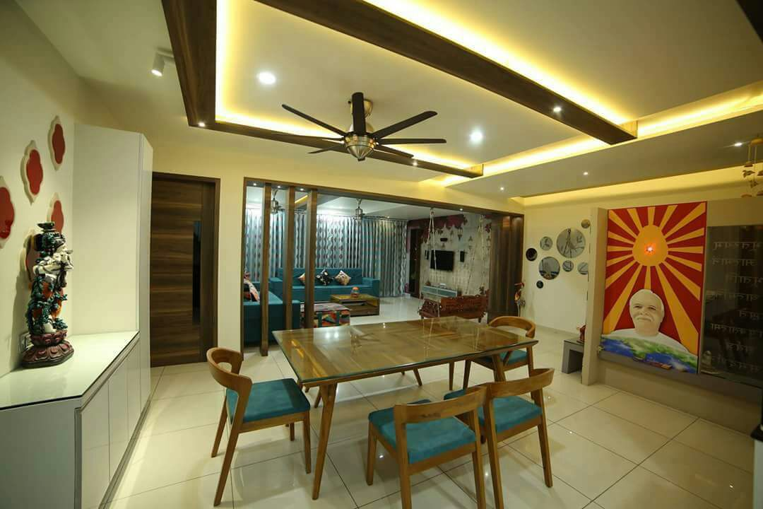 Dinning space with false ceiling and marble flooring with modern display unit by Chandni Goel Dining-room Contemporary | Interior Design Photos & Ideas