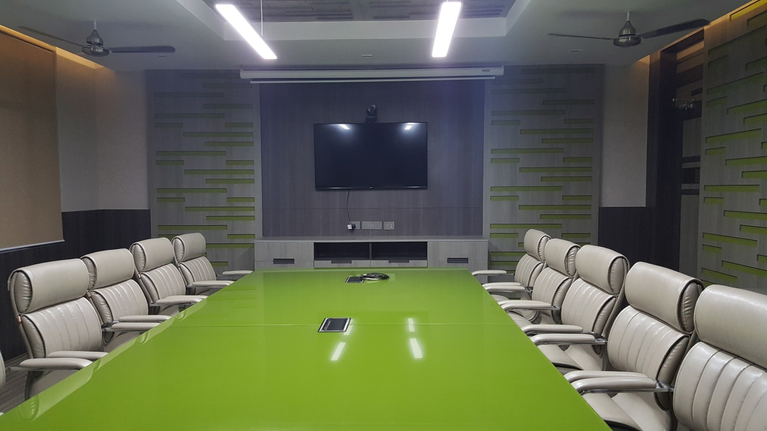 Meeting Room with green table and grey chair by Vishal Arora Modern | Interior Design Photos & Ideas