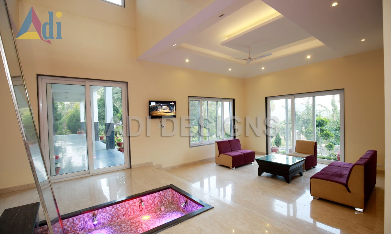 Living space with abstract color wall and maroon sofa by Vishal Arora Living-room Modern   Interior Design Photos & Ideas