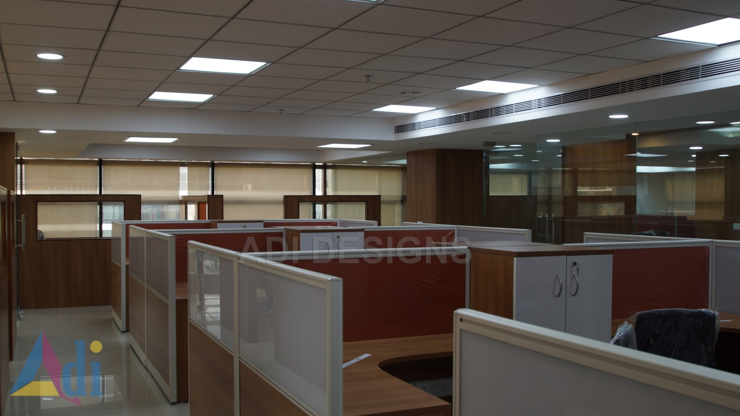 Cellular space office with wooden desk and false ceiling by Vishal Arora Modern | Interior Design Photos & Ideas