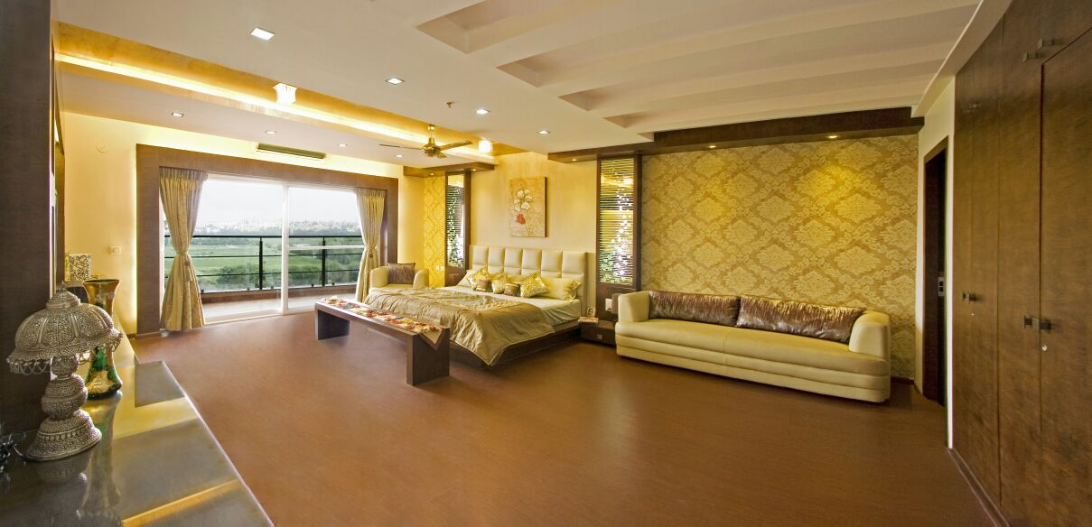 Cream Sofa Set In A Golden Themed Bedroom with Wooden Flooring by Yogendra Garg Bedroom Contemporary | Interior Design Photos & Ideas