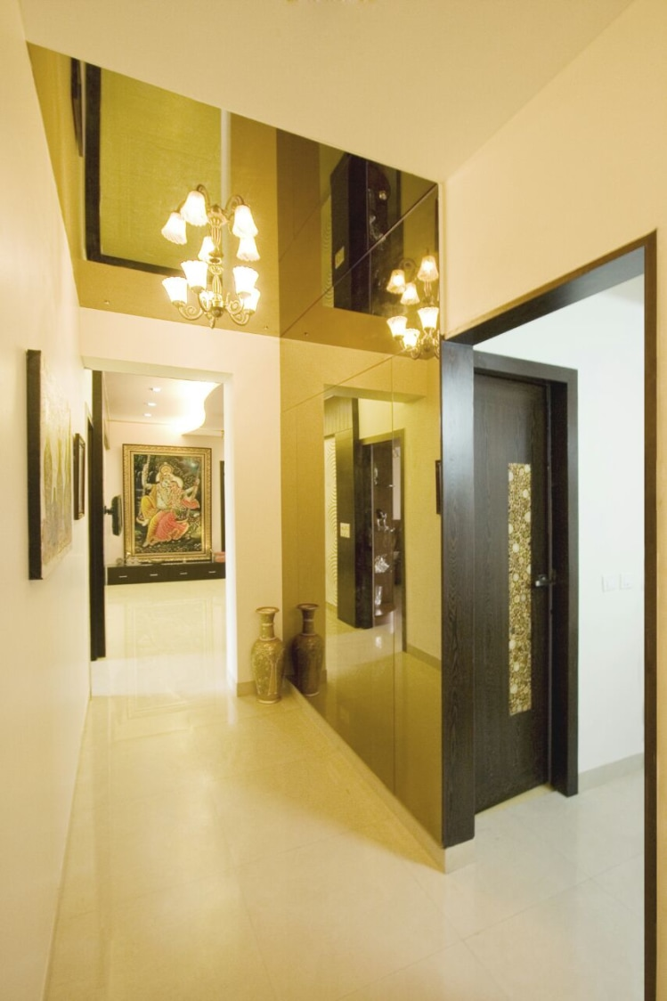 Gold Lamp Chandelier In this Glittering Narrow Hallway by Yogendra Garg Indoor-spaces Contemporary | Interior Design Photos & Ideas