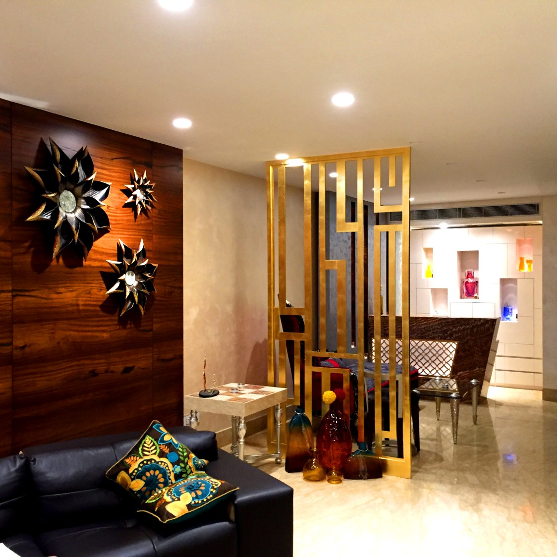 Lavishing Living Area with Wooden Wall Art and Black Sofa ...