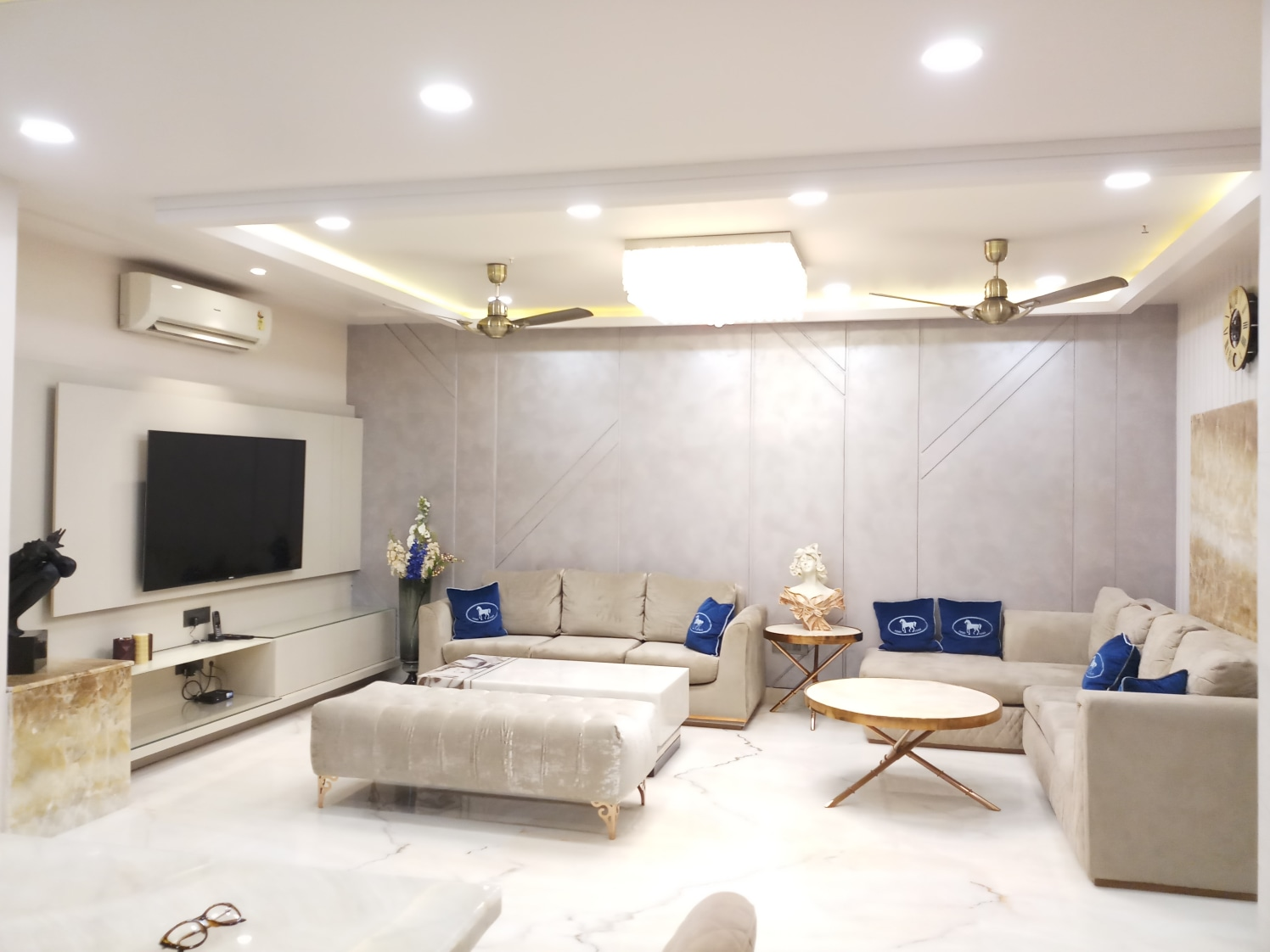 White Themed Living Room with White L Shaped Sofa Set and Circular Centre Table by Sumita Mehra Living-room Contemporary | Interior Design Photos & Ideas