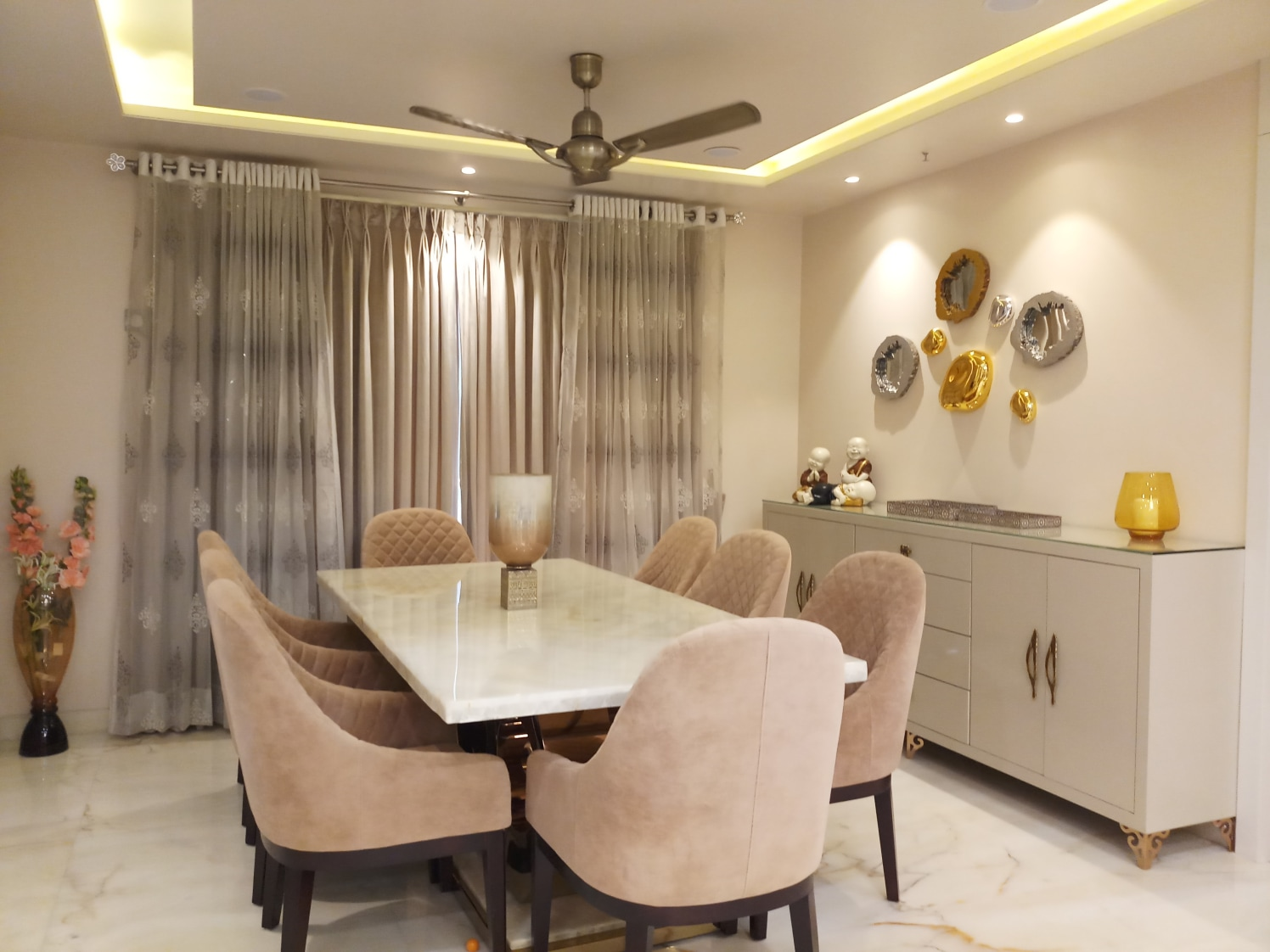 Lavish Dining Area with Beige Cushioned Chairs and White Marble Top table by Sumita Mehra Dining-room Contemporary | Interior Design Photos & Ideas