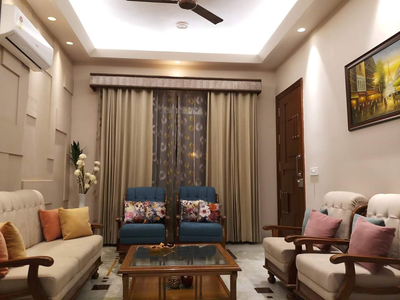 Living Room with Beige Sofa Set and Glass Top Wooden Centre Table by Sumita Mehra Living-room Contemporary | Interior Design Photos & Ideas