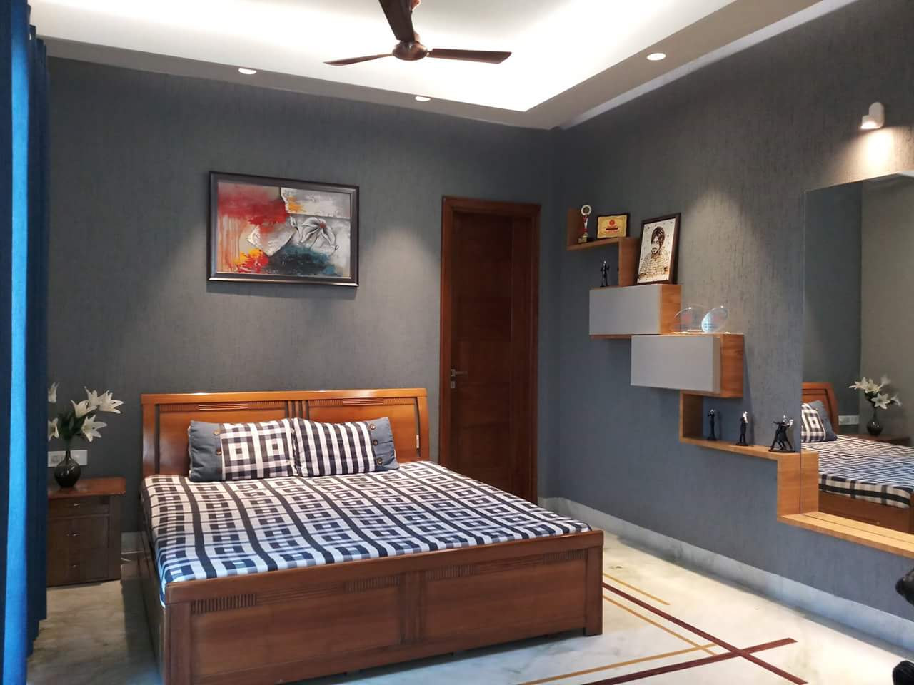 Queen Size Wooden Bed with Wooden Display Panels Hinged To Blue Wall by Sumita Mehra Bedroom Contemporary | Interior Design Photos & Ideas