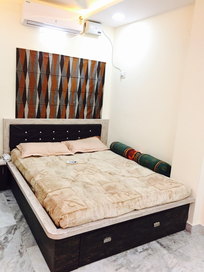 Let's Rest:Queen size bed with Indian style bolster and dark upholstered headboard by Chaitanya Challa Bedroom Contemporary | Interior Design Photos & Ideas