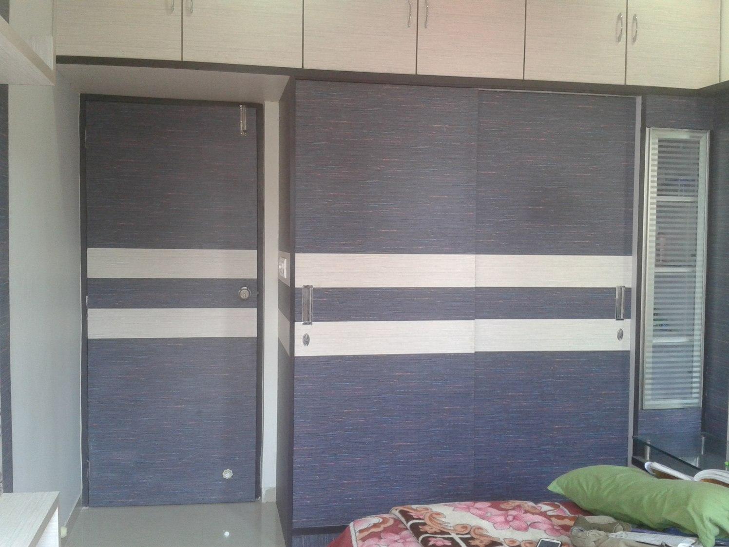 Beautiful striped  wardrobe by Komal Meharchandani Modern | Interior Design Photos & Ideas
