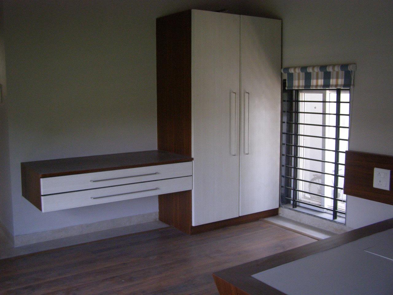 Wooden flooring with wardrobe by Richa Jindal Contemporary   Interior Design Photos & Ideas