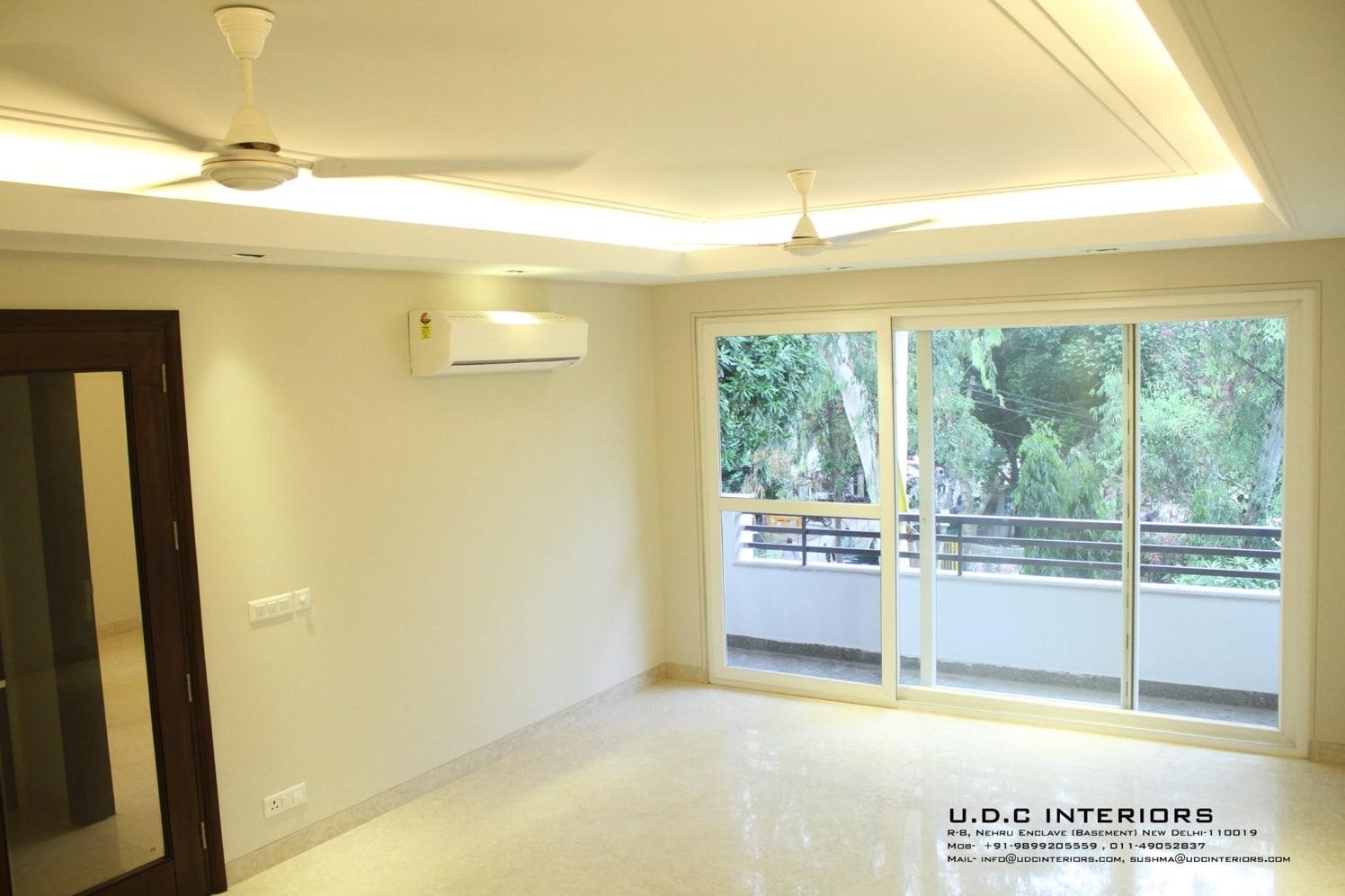 Sharp White Drawing Room by UDC Interiors Living-room Minimalistic | Interior Design Photos & Ideas