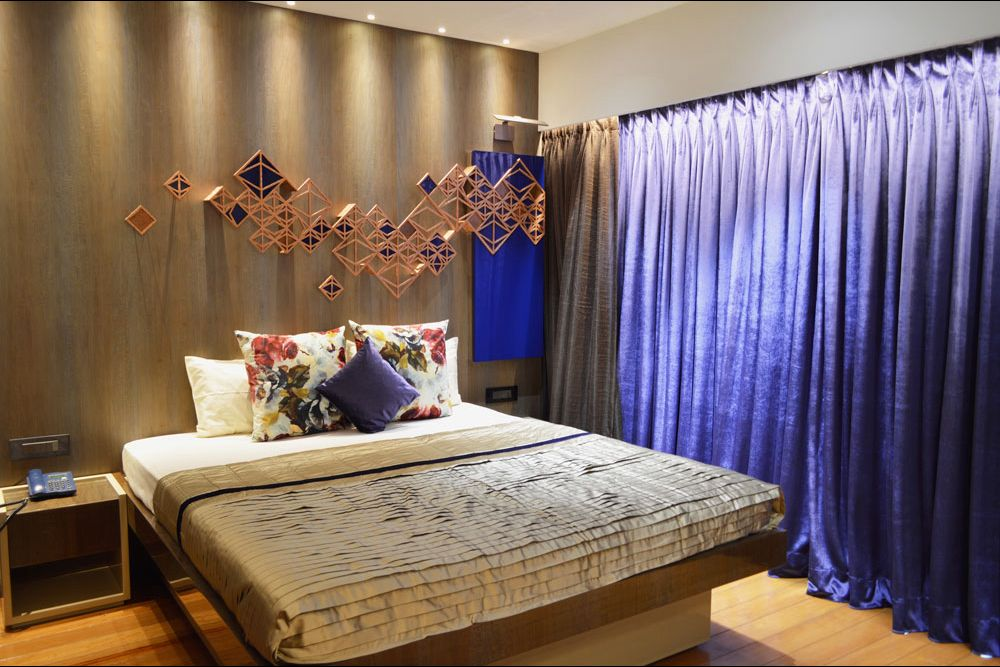 Master bedroom with royal blue upholstery and wall decorative patterns by Gocosy.com Bedroom Modern | Interior Design Photos & Ideas