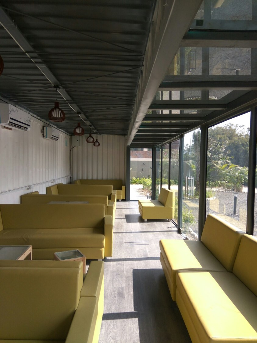 Sitting area of cafe by Nirav Shah