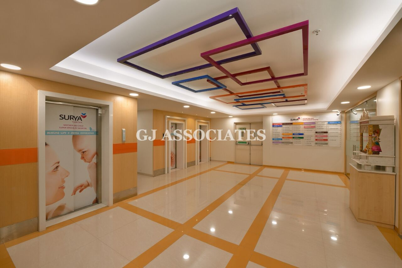 Well-lit Hospital Hallway With White and Beige Marble Floor by Gaurang Jawle Modern | Interior Design Photos & Ideas