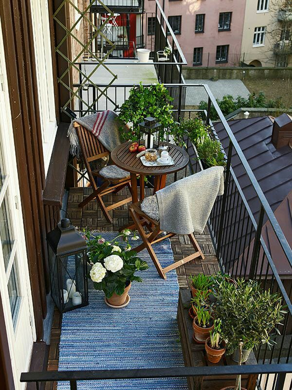 Vintage Balcony With Traditional Wooden Chairs And Blue Rug by Live Fabulous Open-spaces Modern | Interior Design Photos & Ideas