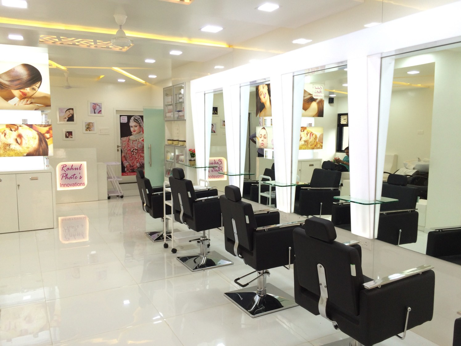 Salon design with black leather chairs by Ameya Pingle Contemporary | Interior Design Photos & Ideas