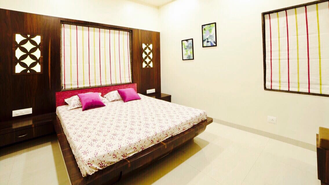 Master bedroom with low rise bed and head side wooden panel by Ameya Pingle Bedroom Contemporary | Interior Design Photos & Ideas