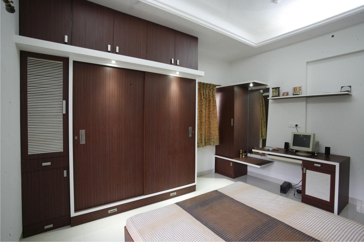 Ebony Wood Wardrobe With Sliding door by Rajas Joshi Bedroom Modern | Interior Design Photos & Ideas