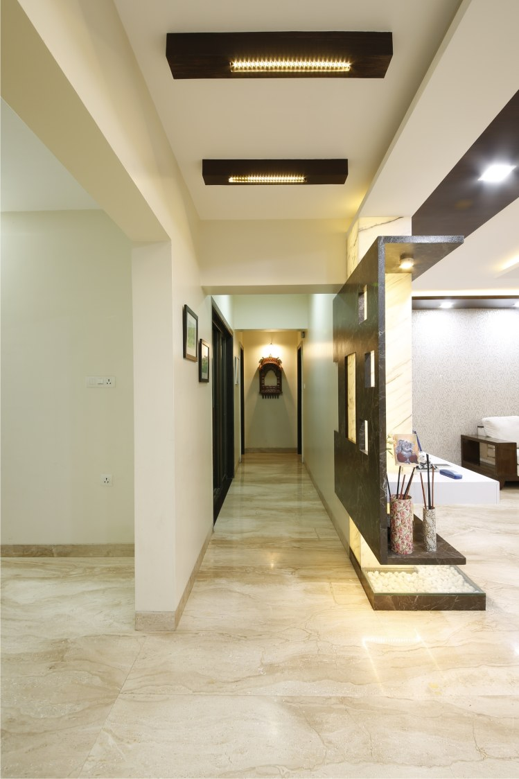 Hallway With Beige Italian Marble flooring and Golden Accent Light by Rajas Joshi Indoor-spaces Modern | Interior Design Photos & Ideas