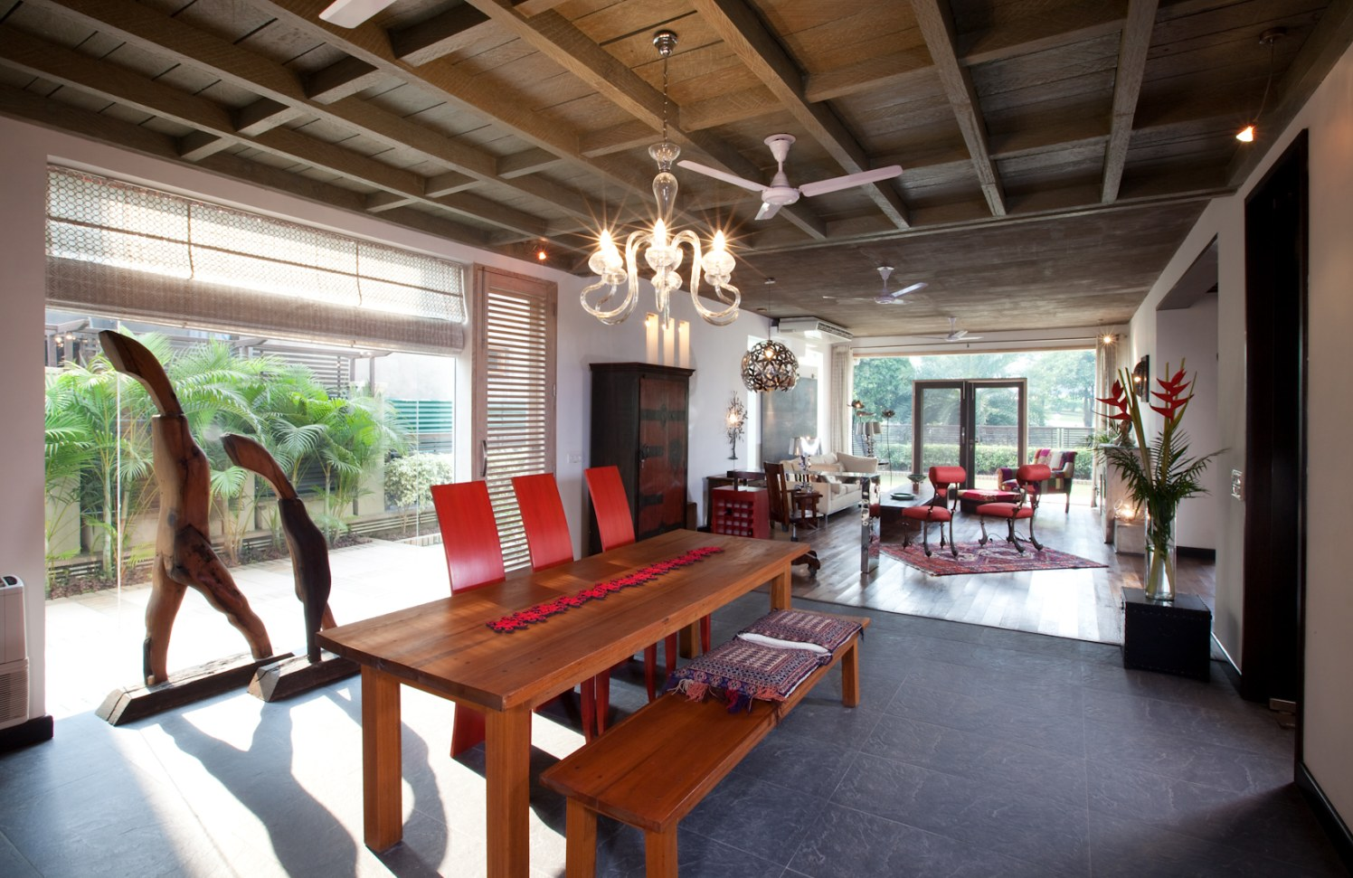 Dining room With Wooden Table And Red Chairs by narayan moorthy Dining-room Contemporary | Interior Design Photos & Ideas